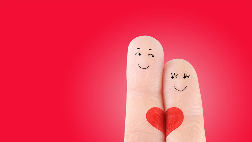 Wellspect Lofric Illustration of two fingers with heart and smiling faces drawn on them